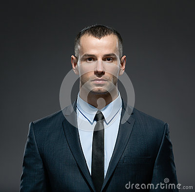 Front view of business man in suit with black tie