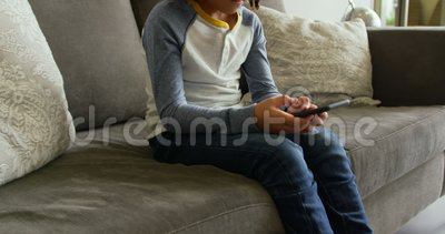 Front view of Caucasian boy playing game on mobile phone in lobby at hospital 4k. Front view of Caucasian boy playing game on mobile phone in lobby at hospital stock video