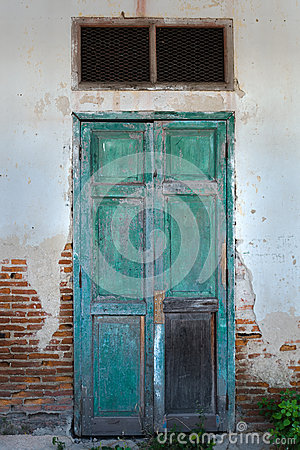Front View of Old Grunge Green Wood Door