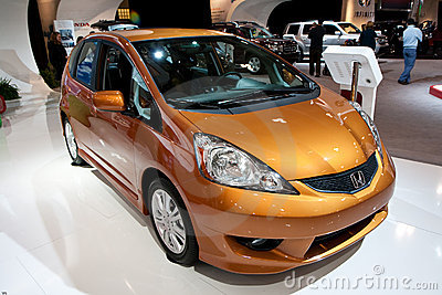 Front view of an Orange Metallic Honda Fit Editorial Stock Photo