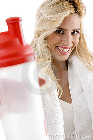Front View Of Smiling Female With Sipper Bottle Royalty Free Stock Image - Image: 7367846