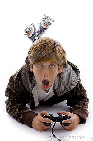 Front view of surprised kid playing videogame