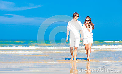 Front view of young happy caucasian couple in