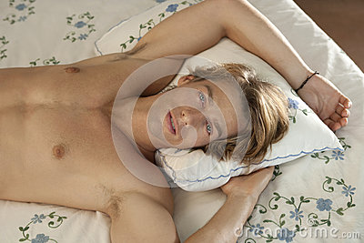 Frontal Portrait of Man in Bed