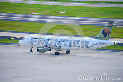 Frontier Airlines plane on the airport tarmac Editorial Image
