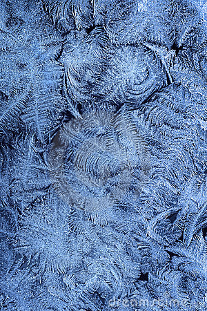Frost patterns on window glass in winter