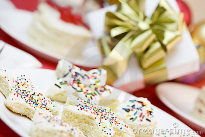 Frosted cake pieces with sprinkles