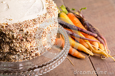 Frosted carrot cake with fresh carrots