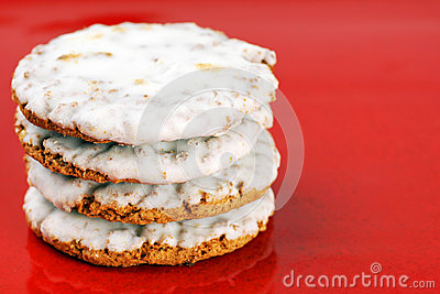 Frosted cookies on red