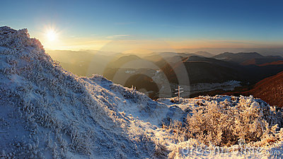 A frosty sunset panorama in beauty mountains.
