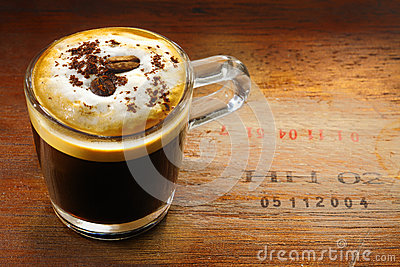 Frothy cup of cappuccino coffee