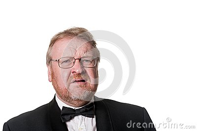 Frowning Middle Aged Man In Tuxedo On White Stock Photo ...