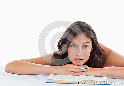 Frowning student head on her books