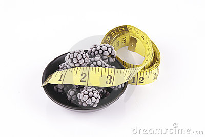 Frozen Blackberries in a Dish with Tape Measure