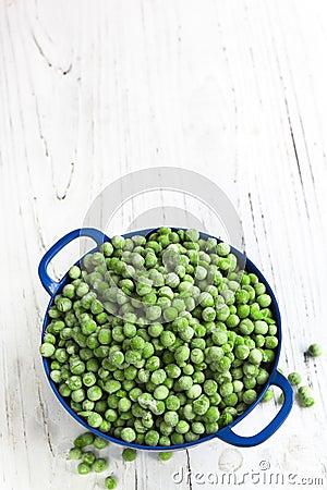 Frozen Peas in Blue Colander