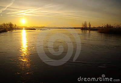 Frozen river at sunrise