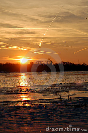 Frozen river sunset