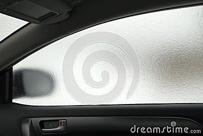 Frozen side window of the car