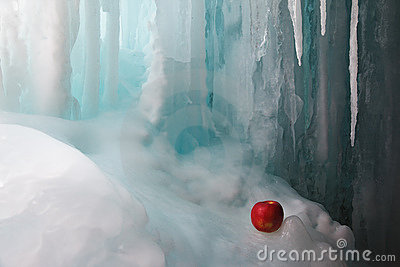 Frozen waterfall and apple