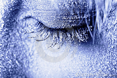 Frozen woman s eye covered in frost