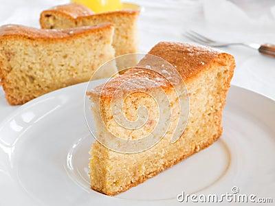 Fruit cake slices on white dish.