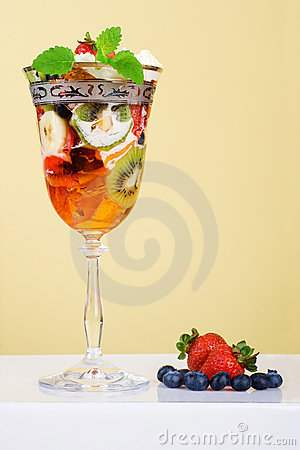 Fruit dessert with jelly in elegant glass.