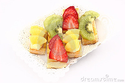 Fruit dessert of kiwi, pineapple and strawberries