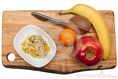 Fruit and fruit salad on cutting board