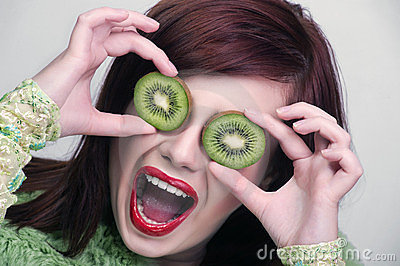 Fruit funny woman holding kiwi