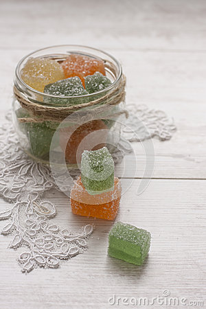 Fruit jelly candies in decorated glass jar