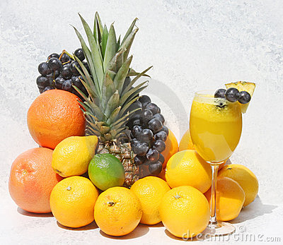Fruit Juice In Wine Glass and Fresh Fruit