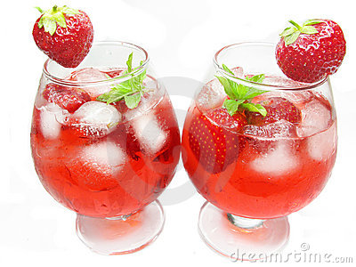 Fruit punch cocktails with ice and strawberry