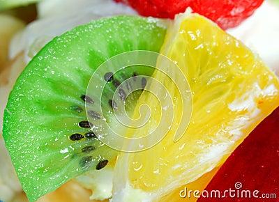 Fruit salad with a strawberries, orange and kiwi