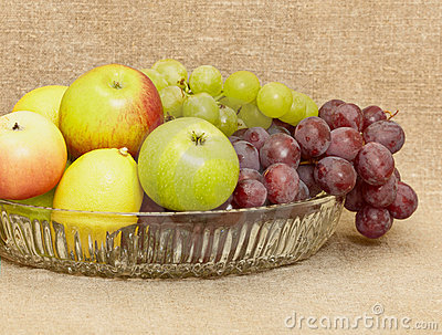 Fruit in vase - lemons, apples, grapes
