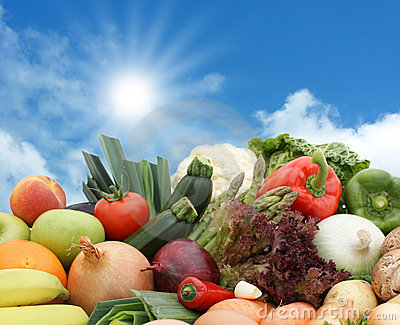 Fruit and vegetables against a sunny sky