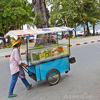 Fruit vendor pushing his cart. Editorial Photo