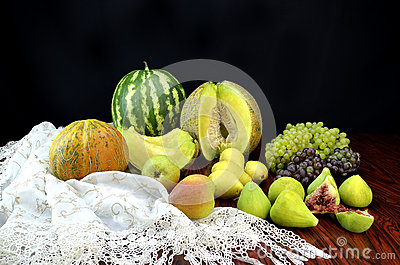 Fruits and crochet lace tablecloth