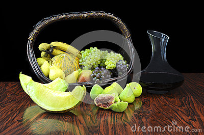 Fruits and jug with wine