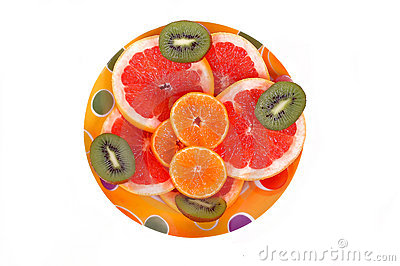 Fruits plate with grapefruit, kiwi and orange slices