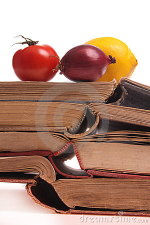Fruits and vegetables on old books