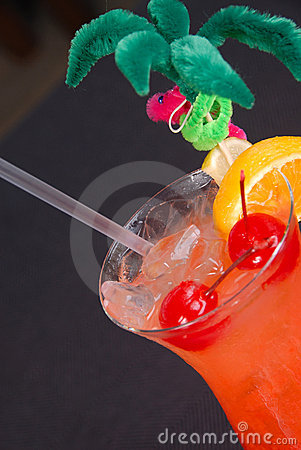 Fruity hurricane cocktail in tropical glass.