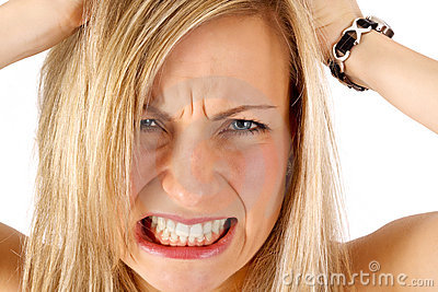 Frustrated blonde tearing her hair