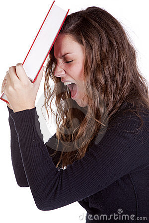 Frustrated with book against head