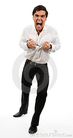 Frustrated business man tearing apart his shirt