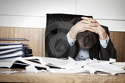 Frustrated business person overloaded with work.