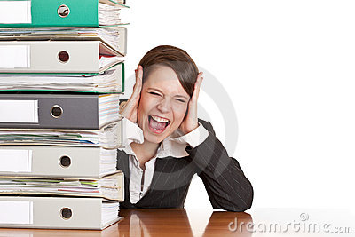 Frustrated business woman cries near folder stack