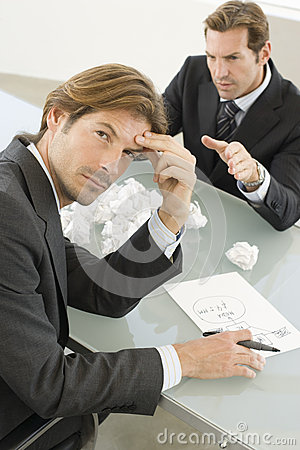 Frustrated Businessman With Manager Shouting At Him