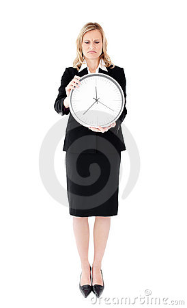 Frustrated businesswoman holding a clock
