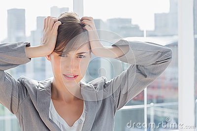 Frustrated businesswoman looking at camera