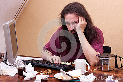 Frustrated man sitting on the computer and is thinking